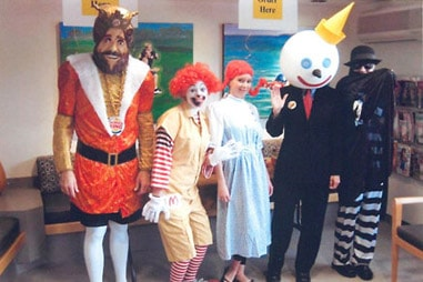 The team at Nelson Orthodontics dressed up as fast food mascots.