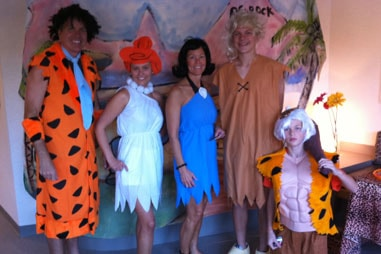 The team at Nelson Orthodontics dressed up as the cast of The Flintstones.
