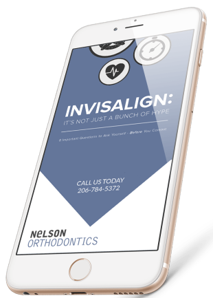 Homepage preview of our free eBook as displayed on an iPhone, title Invisalign: It's Not Just A Bunch of Hype.